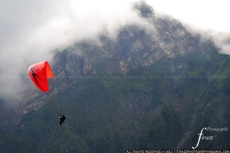 Paragliding between the clouds